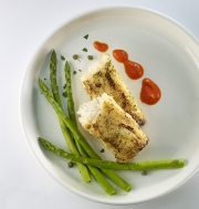 Food photography fire roasted garlic herb cod and vegetables
