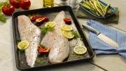 Food photography Hake fish raw lemon peppers dill prepared