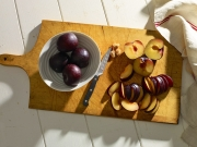 plums cutting board knife food photography