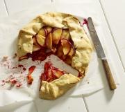 plum pie baked process parchment paper cut open eaten