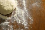 dough ball and flour on cutting board