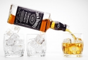 jack daniels pouring into a glass of ice