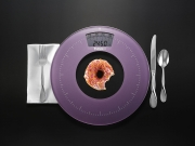 scale and donut conceptual photograph