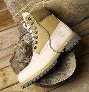 timberland sheet boots on a wood stump