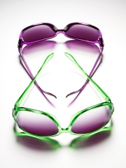 photography pair of colorful sunglasses conceptual purple green