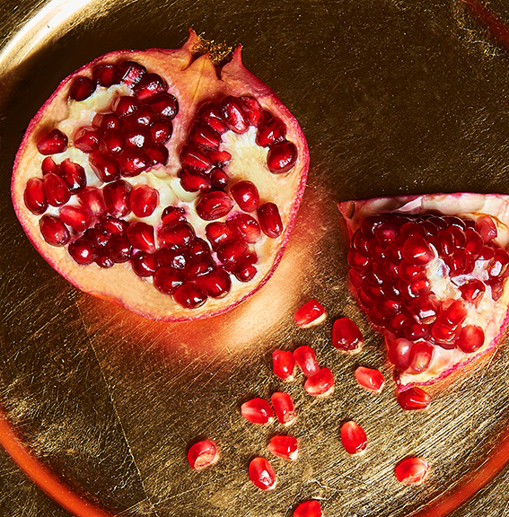 Pomegranate on a gold plate